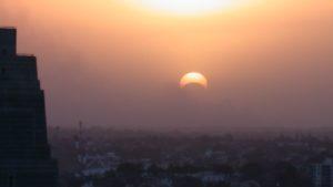 Solar eclipse through bushfire smoke 4 Dec 2002